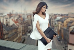 Elegant Woman on Roof of Building